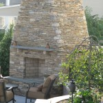 Millcreek Landscape Design backyard landscaping and stone fireplace