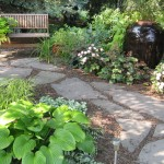 Millcreek Landscape Design rock pathway and planting around a bench