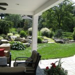 Millcreek Landscape Design patio design and landscaping in residential backyard