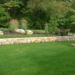 Millcreek Landscape Design stone wall with planting and mulching service