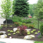 Millcreek Landscape Design planting, rocks, trees, and mulching