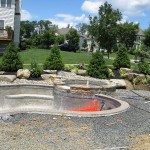 Millcreek Landscape Design backyard landscaping around a pool before photo