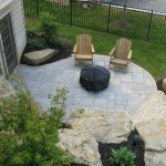Millcreek Landscape Design backyard landscaping and hardscape patio with large rocks and stone patio