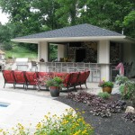Millcreek Landscape Design backyard patio with outdoor kitchen and bar