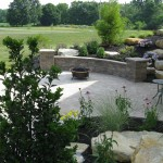 Millcreek Landscape Design stone patio with fireplace
