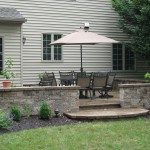 Millcreek Landscape Design backyard patio with outdoor table and chairs