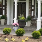 Millcreek Landscape Design entry way with landscaping along stone pathway to residential home