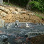 Millcreek Landscape Design worker in progress laying down stones