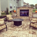 Millcreek Landscaping Design backyard hardscape patio design with grill, tv, and seating area