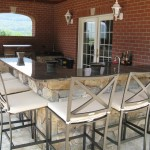 Millcreek Landscape Design backyard outdoor kitchen and bar