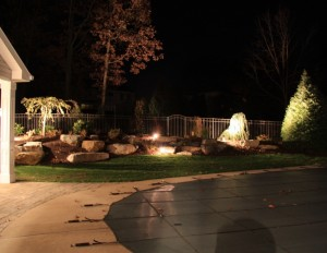 Millcreek Landscape Design with accent lighting at night