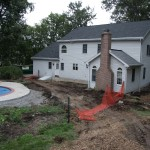 Millcreek Landscape Design swimming pool large rocks and planting before photo