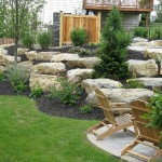 Millcreek Landscape Design backyard landscaping and hardscape patio with large rocks
