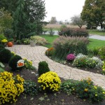 Millcreek Landscape Design walkway with planting, mulching, and accent lighting up to front door