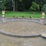 Millcreek Landscape Design hardscaping backyard circle stone patio with planting and mulching