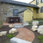 brick paver patio area of yellow house