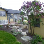 landscaping area of yellow house