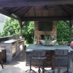 outdoor kitchen & stone fireplace