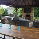 outdoor dining area with stone fireplace