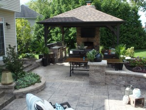 outdoor stone kitchen & fireplace