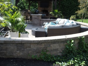 Outdoor kitchen & patio with wicker furniture