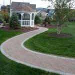 brick pavers leading to white gazebo