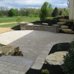 Millcreek Landscape Design stone backyard patio circle shape