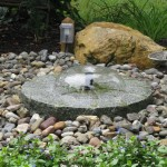Millcreek Landscape Design small stone water feature