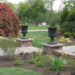 Millcreek Landscape Design entry way with two columns stone pathway to residential home