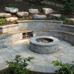 Millcreek Landscape Design stone patio with fireplace in the center