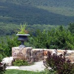 stone retaining wall over looking mountains