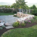 stone paver patio with stone retaining wall
