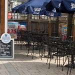 samual adams tables on brick paver patio